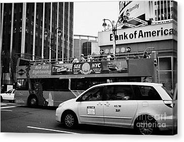 Gray Line New York Sightseeing Bus And Yellow Mpv Taxi Cab On 7th Avenue New York City Canvas Print by Joe Fox