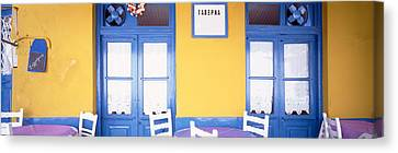 Greece, Hydra, Empty Restaurant Canvas Print by Panoramic Images