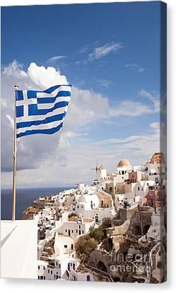 Greek Icon Canvas Print - Greek Flag Waving On Oia - Santorini - Greece by Matteo Colombo