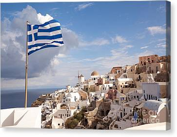 Greek National Flag Waving Over Oia - Santorini - Gr Canvas Print by Matteo Colombo