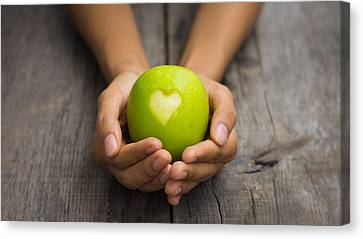 Green Apple With Engraved Heart Canvas Print by Aged Pixel