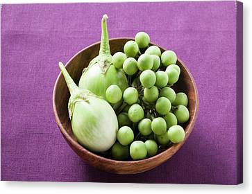 Wooden Bowl Canvas Print - Green Baby Aubergines In Wooden Bowl by Foodcollection