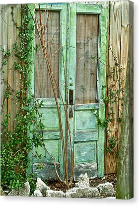 Green Cottage Doors Canvas Print by Angie Mahoney