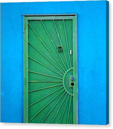Green Door On Blue Wall Canvas Print by Art Block Collections