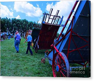 Green Grass And Old Equipments Canvas Print by Tina M Wenger