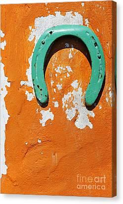 Green Horseshoe Decorating Orange Wall Canvas Print by Sami Sarkis