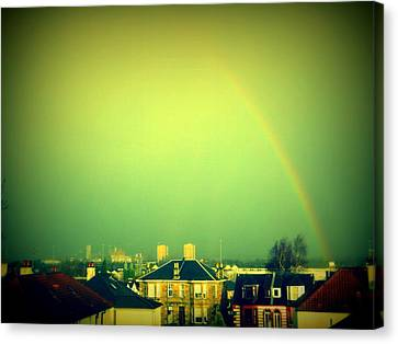 Green Tinted Sky With Rainbow Canvas Print by Mlle Marquee