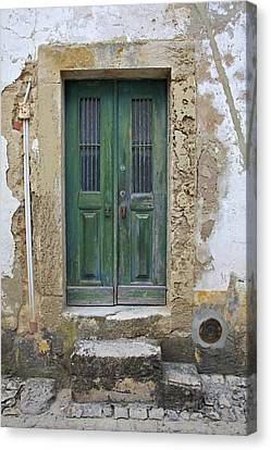 Green Wood Door With Hand Carved Stone In The Medieval Village Of Obidos Canvas Print by David Letts