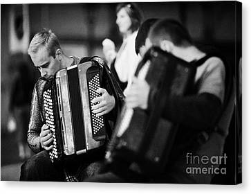 Group Of Accordion Players During Street Performance In Rynek Glowny Town Square Krakow Canvas Print by Joe Fox