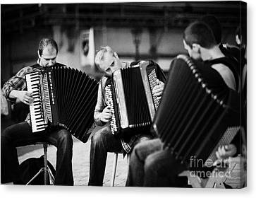 Group Of Accordion Players Perform In The Street In Rynek Glowny Town Square Krakow Canvas Print by Joe Fox
