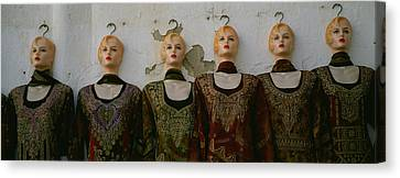 Group Of Mannequins In A Market Stall Canvas Print by Panoramic Images