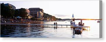 Group Of People At A Waterfront, Lake Canvas Print