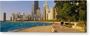 Group Of People Jogging, Chicago Canvas Print by Panoramic Images