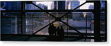 Group Of People Looking At A Memorial Canvas Print