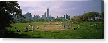 Group Of People Playing Baseball Canvas Print by Panoramic Images