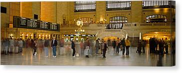 Group Of People Walking In A Station Canvas Print