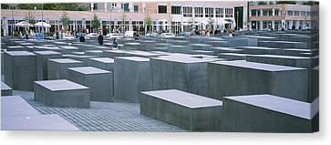 Group Of People Walking Near Memorials Canvas Print