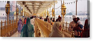 Sikhism Canvas Print - Group Of People Walking On A Bridge by Panoramic Images