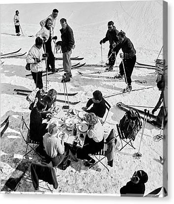 Group Of Skiers At Sant Moritz Canvas Print by Roger Schall