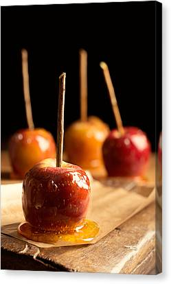 Group Of Toffee Apples Canvas Print by Amanda Elwell