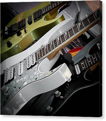 Guitars For Play Canvas Print by David Patterson