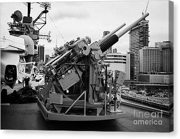 Gun Emplacements On The Flight Deck Of The Uss Intrepid At The Intrepid Sea Air Space Museum Canvas Print by Joe Fox
