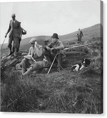 Gurnee Munn And Gurnee Munn Jr. Sitting On Grassy Canvas Print by John Mcmullin