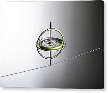 Gyroscope Balancing On A Wire Canvas Print