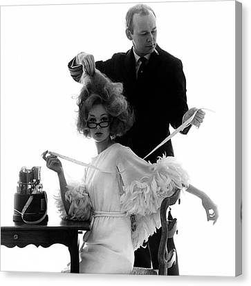 Hairstylist Kenneth Holding The Hair Of A Model Canvas Print by Bert Stern