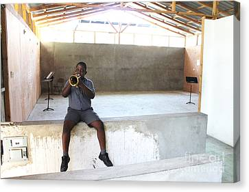 Haitian Boy Plays Trumpet Canvas Print by Jim Wright