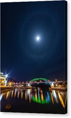 Halo Above The Bridge Canvas Print by Roy Cruz