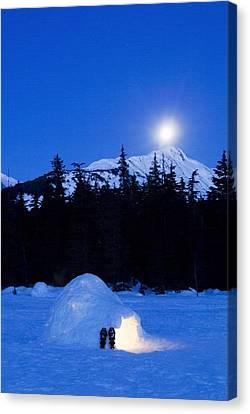 Hand Built Igloo In Moonlight Lit Up Canvas Print by Randy Brandon