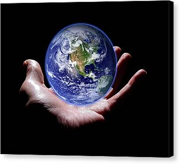 Hand Holding The Earth Canvas Print by Victor De Schwanberg