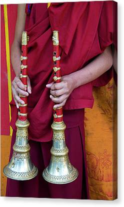 Hands Of Young Monk Holding Ceremonial Canvas Print by Ellen Clark