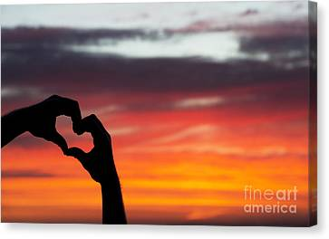 Hands That Help Canvas Print by Tim Gainey