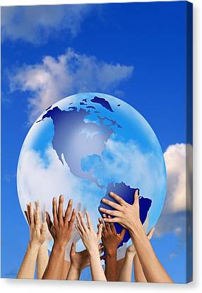 Hands Touching A Globe Canvas Print by Don Hammond
