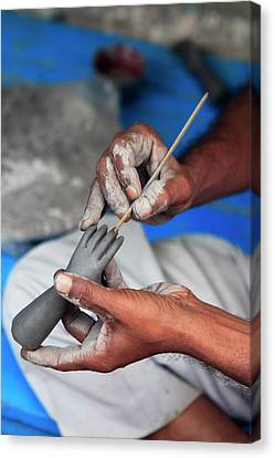 Hands Working On A Hand In The Potter's Canvas Print by Kymri Wilt