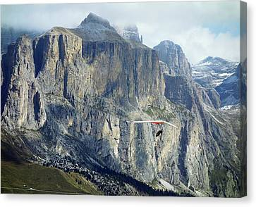 Exhilarating Canvas Print - Hang Glider In The Dolomites by Cordelia Molloy