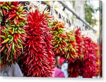 Hanging Chili Pepper Ristras At Farmers Market Canvas Print by Teri Virbickis