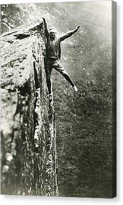Hanging Off Cliff Canvas Print by Retro Images Archive