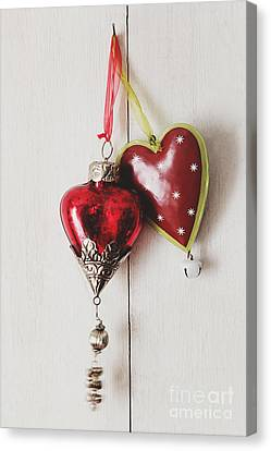 Canvas Print featuring the photograph Hanging Ornaments On White Background by Sandra Cunningham