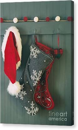 Hanging Stockings And Santa Hat On Hook Canvas Print