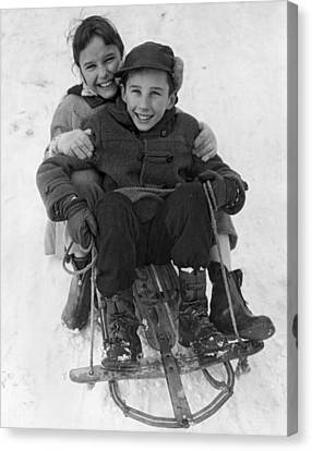 Happy Children On A Sled Canvas Print by Underwood Archives