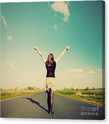 Happy Woman Standing On Empty Road Retro Vintage Style Canvas Print by Michal Bednarek