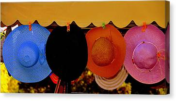 Canvas Print featuring the photograph Hats Of Many Colors by Caroline Stella