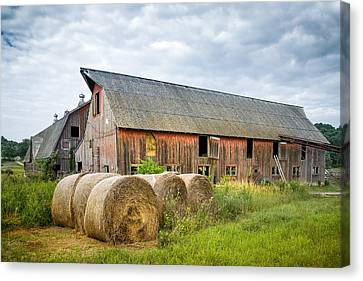 Hay Bales And Old Barns Canvas Print by Gary Heller