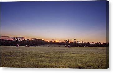 Hay Bales In A Field At Sunset Canvas Print