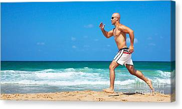 Healthy Man Running On The Beach Canvas Print by Anna Om