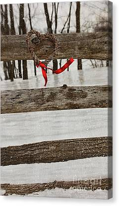 Heart-shape Wreath With Red Ribbon On Fence Canvas Print by Sandra Cunningham