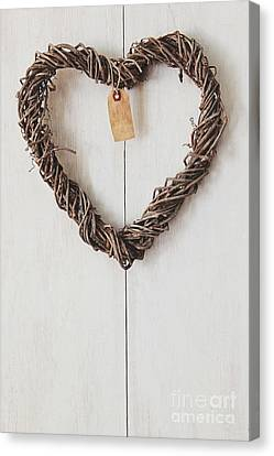 Vine Grapes Canvas Print - Heart Wreath Hanging On Wood Background by Sandra Cunningham
